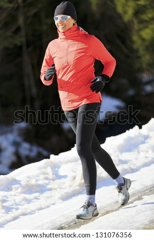 Runner, spring running, exercise woman. Jogging on early spring in mountains. Healthy lifestyle concept. - stock photo