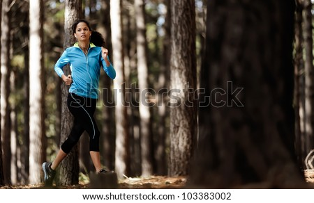 runner trail running training in forest outdoors, healthy fitness wellness athlete portrait - stock photo