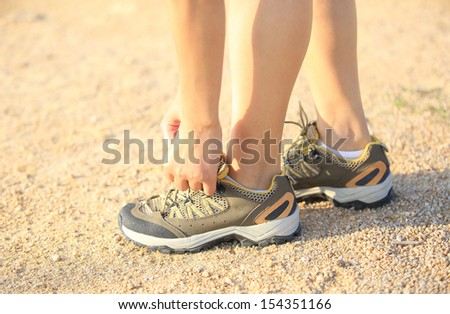 runner try new sports shoes - stock photo
