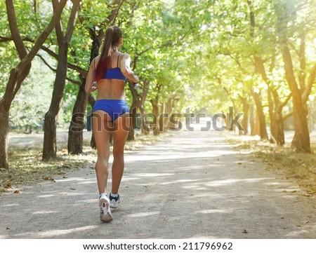 Runner - woman running outdoors training for marathon run.Female fitness concept - stock photo