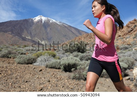 Runner. Woman running outside in beautiful nature. - stock photo