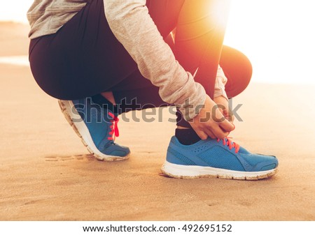 Runner woman tying the shoelaces