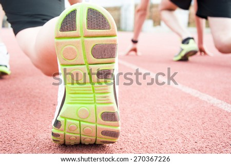 runners at the start of the track - stock photo