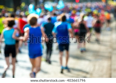 runners in a marathon, abstract blurry - stock photo