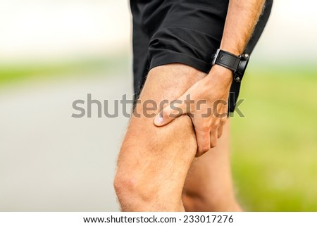 Runners leg and muscle pain on running training outdoors in summer nature, sport jogging physical injury when working out. Health and fitness concept with sore body - stock photo
