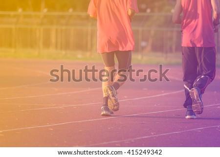 Runners running on Running track - stock photo