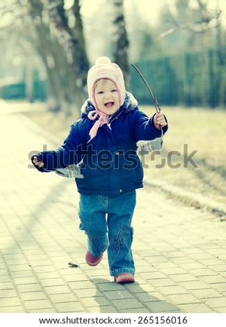 Running baby in cap. Vintage style. - stock photo