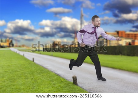 Running businessman in a hurry with modern city in background - stock photo