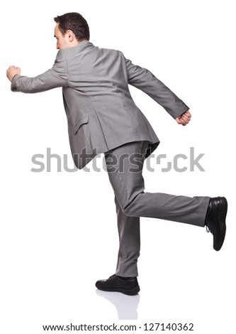 running businessman isolated on white background