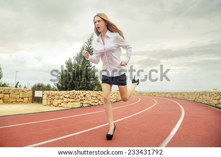 Running businesswoman  - stock photo