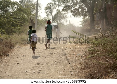 Running children on the country road - stock photo