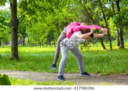Running couple doing stretching exercises in the park
