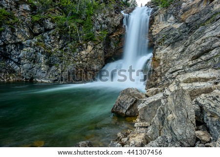 Running Eagle Falls - A close-up spring view of Running Eagle Falls at Two Medicine Valley region of Glacier National Park, Montana, USA. - stock photo