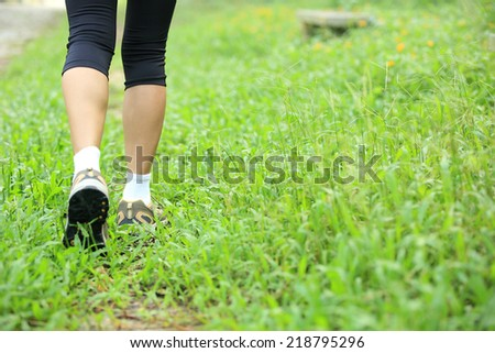 running feet on green grass