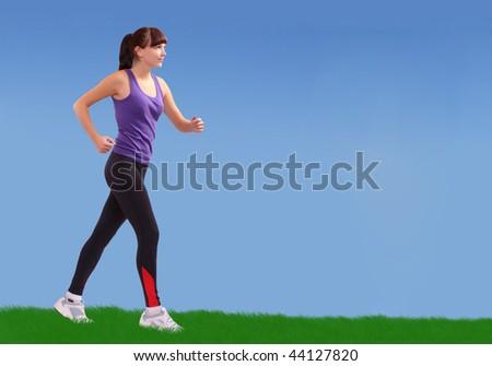 Running girl along meadows. Active lifestyle concept. - stock photo