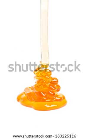running honey on white background - stock photo