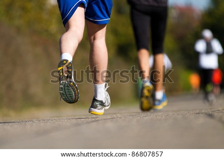 running in a marathon competition - stock photo