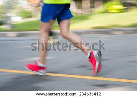 running in park, blurred motion abstract background