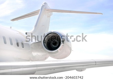 Running Jet Engine on a modern private jet airplane with a tail wing - stock photo