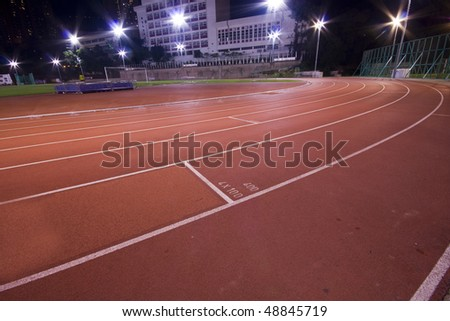 Running lanes on a track in play ground - stock photo