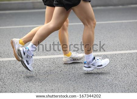 running legs on street  - stock photo