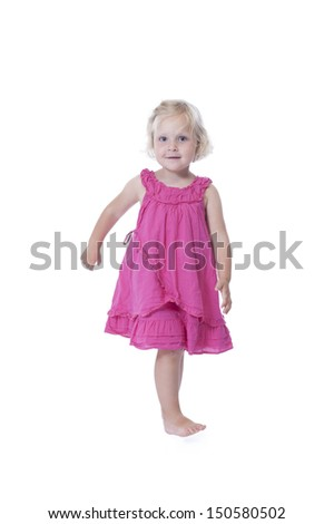 running little girl in pink dress, isolated on white background
