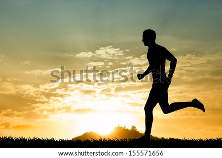 Running man at sunset - stock photo