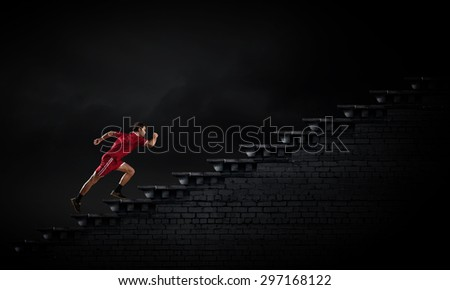 Running man in red sport wear on black background - stock photo