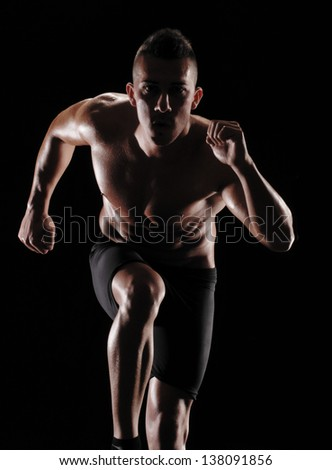 Running man on black background. - stock photo