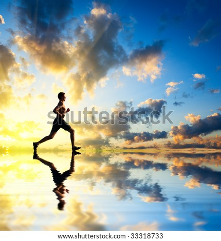 running man sunset and water - stock photo