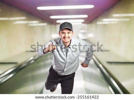 running manual worker and escalator background - stock photo