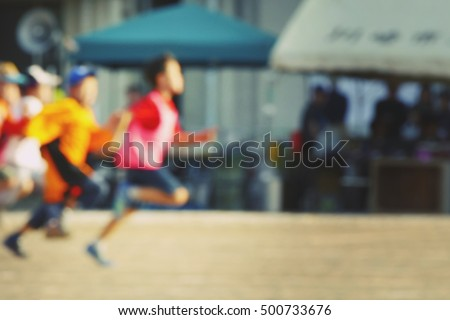running race of blurred image of children. the concept of competition, to win, to be number one and the concept of raising a kid