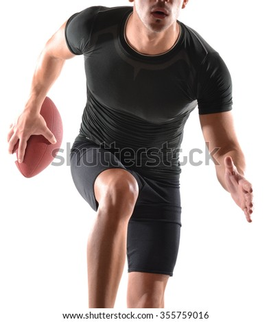 Running rugby player holding a ball on white background.Strong player portrait. - stock photo