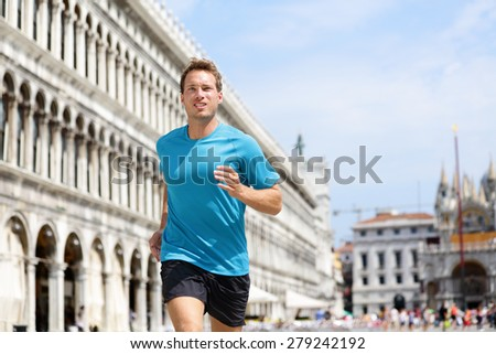 Running runner man jogging in Venice. Male sport athlete training on travel vacation as tourist on Piazza San Marco Square, Venice, Italy, Europe. - stock photo