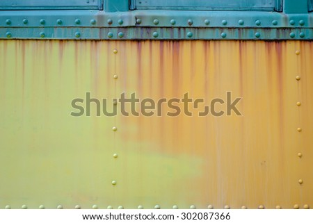 Running rust down the side of an abandoned rail passenger car - stock photo