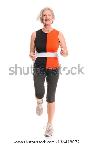 Running senior woman in front of white background - stock photo