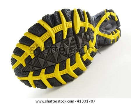 Running Shoe with yellow and black tread pattern on white - stock photo