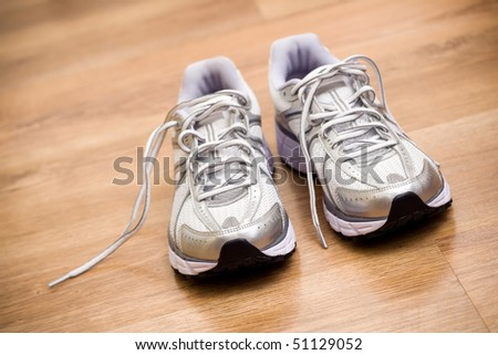 Running shoes after workout at gym.Shallow depth of field with focus on front of the shoes. - stock photo