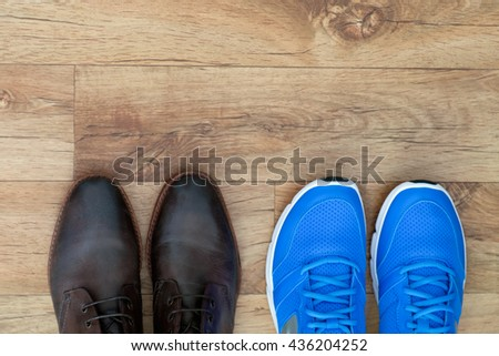 Running shoes and formal shoes - stock photo