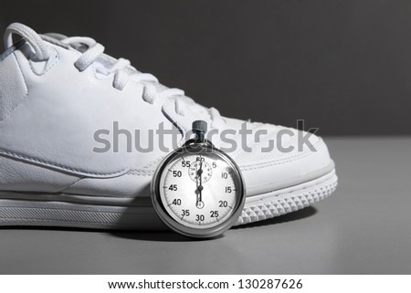 Running Shoes and stopwatch - stock photo