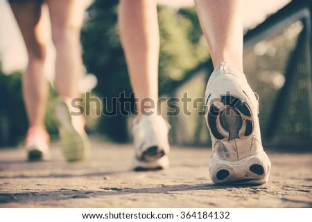 Running shoes close up at the park - stock photo