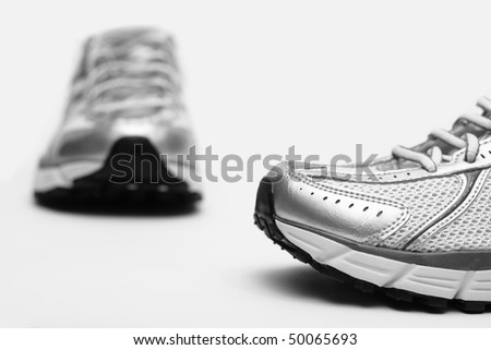 Running shoes closeup on white background - stock photo
