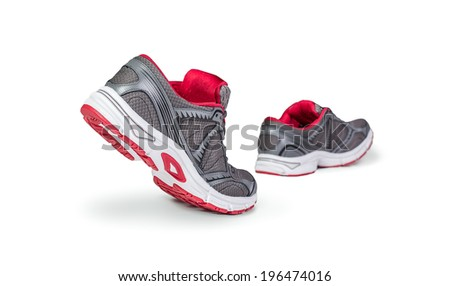 Running shoes in motion - stock photo