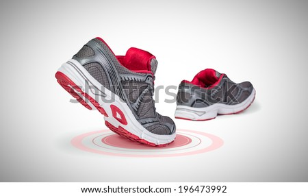 Running shoes in motion with pressure point marked - stock photo