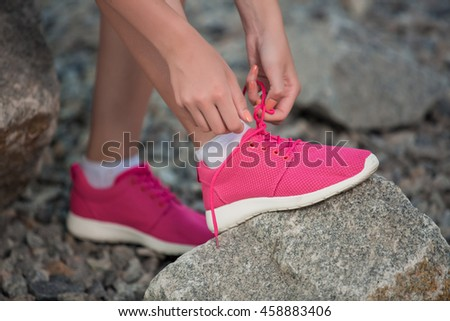 Running shoes - woman tying shoe laces.