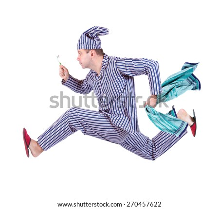 running sleeper isolated on white background. Man in pajamas in a hurry with a toothbrush and a towel. Man in pajamas and a sleeping cap runs on a white background. Rush man in pajamas. - stock photo