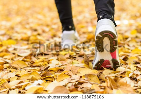 Running sport concept .Closeup of woman barefoot runner shoes. Female jogging on autumn. Copyspace. - stock photo