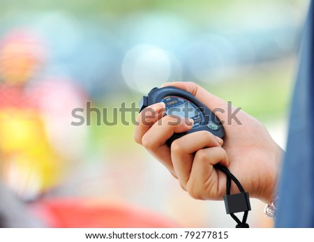 Running stopwatch in the hand - stock photo