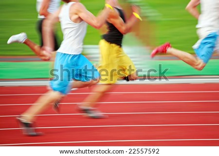 Running the race (motion blur) - stock photo