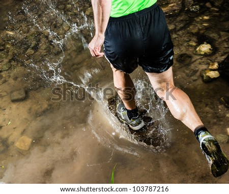 running through a streambed - stock photo
